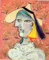picasso 1930s woman with straw hat on a background of flowers